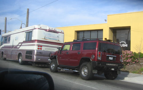 Giant RV towing giant Hummer