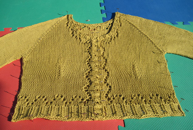 Eyelet sweater being blocked