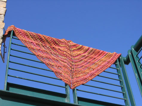The shawl over a railing.