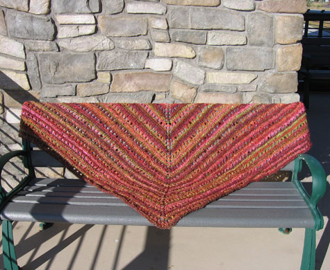 The shawl on a bench.