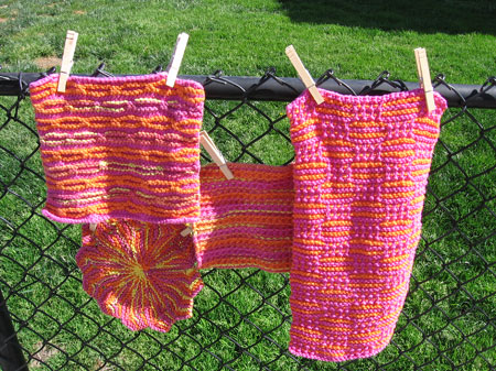 Pink washcloths all in a row.