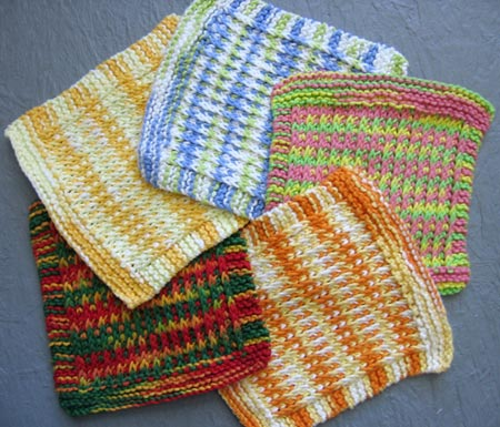 Five lovely and colorful washcloths.